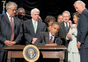 President Obama signing the Dodd-Frank Act